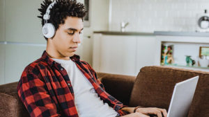 Student_on_laptop_at_home_on_couch
